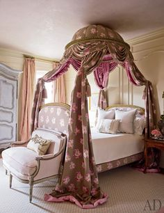 A* lit à la polonaise* draped with a floral fabric anchors the daughter's bedroom; the Louis XVI marquise is upholstered in a Rubelli fabric, and the carpet is by Stark.