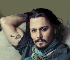 Johnny Depp <3 sorry sweetie I love you but I had to pin. Just saw his tattoo...