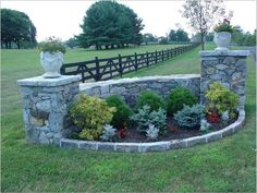 I love the round element as well as the planters on the columns. Pennsylvania fieldstone driveway wing wall with granite cobblestone wall cap and cobblestone bed edging Driveway Entrance Landscaping, Brick Driveway, Backyard Landscaping, Driveway Culvert, Driveways, Driveway Ideas, Landscaping Ideas, Farm Entrance, Entrance Ideas