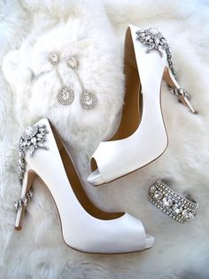 Fabulous accessories for the winter bride. Badgley Mischka shoes, Erin Cole jewelry and a fabulous faux fur to chase away the chill. See more here: https://perfectdetails.com/for-the-bride.htm