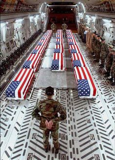 This is the harsh reality of war that is not always seen. In this picture it shows U.S. War casualties in a cargo plane being shipped back to their families for a funeral. Recruiters do not want to show potential enlisters the actuality of war, getting killed in action, which is common in battle. I wonder if some of the military personnel wish they saw both sides of war, and would have still enlisted.