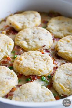 What can be better than a creamy chicken and bacon pot pie, topped with bacon cheddar biscuits? It is said that bacon makes everything better, and this Chicken and Bacon Pot Pie with Bacon Cheddar Biscuits is proof that it is true!::