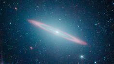 The Sombrero Galaxy Named after its appearance in visible light to a wide-brimmed hat -- this galaxy is in fact two galaxies in one. It is a large elliptical galaxy (blue-green) with a thin disk galaxy (partly seen in red) embedded within. Previous visible-light images led astronomers to believe the Sombrero was simply a regular flat disk galaxy. CREDIT: NASA/JPL-Caltech