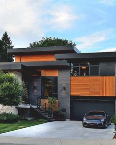 Stunning Modern Mansions - DuJour : See contemporary architecture inspiration, including a garage underneath a pool. See contemporary architecture inspiration, including a garage underneath a pool. Architecture Design, Contemporary Architecture, Contemporary Design, Landscape Architecture, Black Architecture, Creative Architecture, Contemporary Building, Contemporary Cottage, Kitchen Contemporary