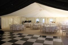Stunning black & white marquee linings and complementary dance floor