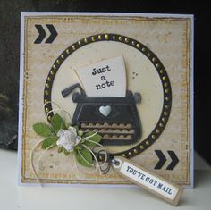 Handmade card by DT member Boukje with Collectables Typewriter (COL1358), Snowglobe (COL1362), Creatables Build-a-Rose (LR0398) and Design Folder Chevrons (DF3407) from Marianne Design
