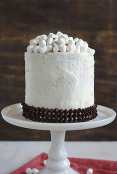 Hot Chocolate Cake - Three layers of chocolate cake with layers of marshmallow buttercream in between and topped with chocolate chips and mini marshmallows! Chocolate Shavings, Chocolate Cups, Beautiful Cake Designs, Beautiful Cakes, Birthday Cake Maker, Marshmallow Buttercream, Piping Frosting, Hot Cocoa Mixes, Cake Makers