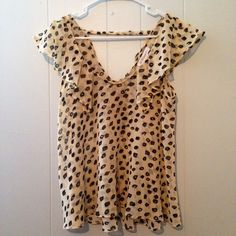 Bcbg Cheetah Print Top BCBGeneration cheetah print top with frills around the neckline and v-back with strap across. Light weight and sheer! This is a great summer top! Size Small BCBGeneration Tops
