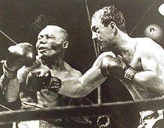 The ko of joe Walcott by rocky Marciano to retain the heavyweight title