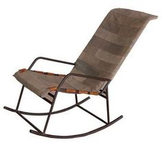 """Iron-frame rocking chair with stretched, patchwork canvas upholstery.     Product: Rocking chair    Construction Material: Iron, reclaimed military canvas and leather    Color: Black and tan   Features:  Striking design    Will enhance any decor   Dimension: 35"""" H x 20"""" W x 22"""" D"""