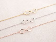 This dainty infinity charm bracelet is classic, fluid, modern, and romantic for everyday wear. Think love, for it is infinite, boundless, ageless, and everywhere. Also available in Silver and Rose Gol