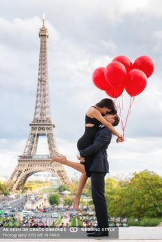 paris france engagement shoot red ballons dressed up suite and dress eiffel tower