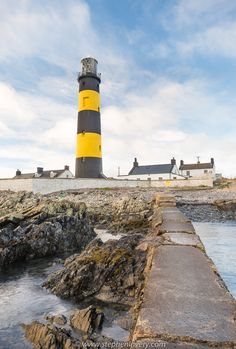 St. John's Point Lighthouse: an old (still operational) lighthouse located at Killough, County Down, Northern Ireland.  The Lighthouse has a very interesting history and is a 'must see' for visitors to the Newcastle, County Down area.  httpi://www.stephenlavery.com