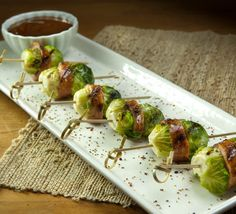 Try this Kiolbassa Smoked Meats recipe tonight! Brussel Sprouts Calories, Grilled Brussel Sprouts, Sprouts With Bacon, Potluck Appetizers, Smoked Sausage Recipes, Slider Recipes, Sprout Recipes, Food 52, Grilling Recipes