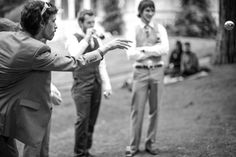Guests play boules at a wedding at Alberton House, Mt Albert, Auckland. Black and white.  BeSo Studios create beguiling fine art family photographs for the walls of the most discerning clients homes. We specialise in wedding and family portrait photography, and supply prints on the highest quality media, framed in beautiful conservation standard frames. We are a high end studio located in the beautiful city of Auckland, New Zealand.