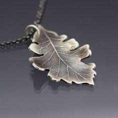 Jewelry Box Sterling Silver Bur Oak Leaf Necklace by Lisa Hopkins Design - This necklace features a hand drawn bur oak leaf design etched into sterling silver. It has been hand cut and gently formed. The piece has been. Diamond Initial Necklace, Diamond Cross Necklaces, Diamond Solitaire Necklace, Leaf Necklace, Nameplate Necklace, Metal Clay Jewelry, Leaf Jewelry, Pendant Jewelry, Jewelry Box