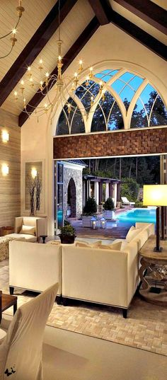 Barn roof, cathedral ceiling, rose window, indoor/outdoor living, chandelier #luxury -Luxurious spaces