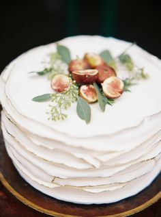 Gold trimmed ruffled autumn wedding cake with decorative figs: http://www.stylemepretty.com/2015/11/25/english-inspired-autumn-wedding-inspiration/ | Perry Vaile - http://www.perryvaile.com/