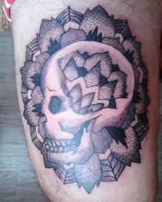 Dorwork mandala skull tattoo