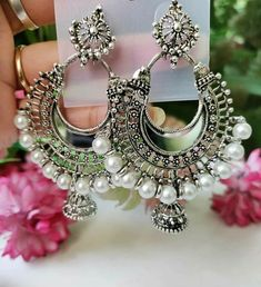 DM us to order. Mirror and white pearl earrings. Order now WhatsApp - 9810604969 Indian Jewelry Earrings, Indian Jewelry Sets, Silver Jewellery Indian, Jewelry Design Earrings, Ear Jewelry, Girls Jewelry, Silver Jhumkas, Silver Jewelry, Sterling Jewelry