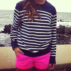 navy stripes and neon pink shorts.