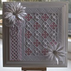 """Pinner says: Spellbinders Grand squares, Sue Wilson embossing folder heart lattice, Spellbinders our daily bread quatrefoil die, SB delicate asters, the swirl is from SB jewel flowers and flourishes. The Lattice is a martha stewart garden trellis punch.    All I did was just matt with cream card and layer them up with foam pads, Cut out another quatrefoil in pink glitter card and glued the """"waste"""" pieces in the gaps."""