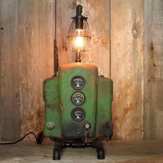 Tractor Lover's Industrial Lamp This is the ultimate tractor lover's industrial table lamp. It features a John Deere 1948 B Tractor dash panel and 3 new John Deere gauges with lights that illuminate with a turn of the key. This lamp stands 26 1/2 inches tall, 12 inches wide and 6