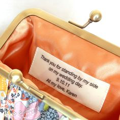 Custom message on a wide satin ribbon for your bridesmaids. Bagatelles and Co clutch. $10.00, via Etsy.