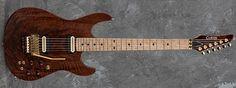 Carvin Guitars C66C, figured Claro walnut (FW4), black limba neck and body (NLMB), matching Claro walnut headstock (FWPH4), reverse inline headstock (RIN), birdseye maple fingerboard (BMF), black acrylic diamond inlays (DBA), Floyd Rose locking nut (LN), stainless steel jumbo frets (STJF), gold hardware (G), rosewood knobs (WK), abalone logo (ABL), piezo bridge w/ 2 C22 humbuckers (P), active electronics for piezo bridge (ACA), cream/black pickups w/ cream rings (407), Dunlop straplocks (SL)