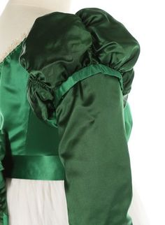Lot 47 - A green satin and whitework ensemble, circa 1820, the spencer bodice in two shades of green satin,