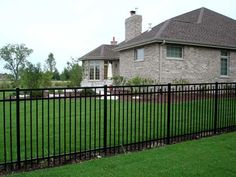 wrought iron fence with mulch around the base.  We just did this!!! No more pain in the butt trimming around fence!