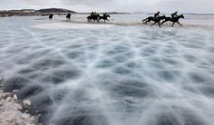 Riders compete on the frozen Yenisei River during the 44th Ice Derby amateur horse race near the settlement of Novosyolovo, some 250 km (155 miles) south of the Siberian city of Krasnoyarsk, March 15, 2014. The Ice Derby has been held in Novosyolovo annually at the end of each winter since 1969, drawing participants from the entire region. (REUTERS/Ilya Naymushin)