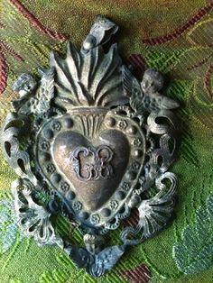 Antique French Ex Voto..also great on a necklace!!