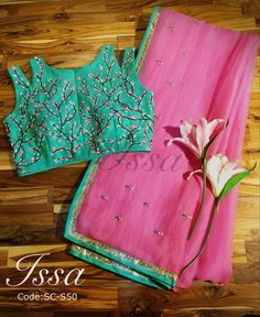 SC50: Our season favorite...Cherry blossom!!! Peach and sea green organza saree with beautiful cherry blossom hand embroidery!!!To order please call/ WhatsApp on 9949944178 or mail us @issadesignerstudio@gmail.com