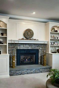Custom built-in wall units around fireplace feature a bar and ...