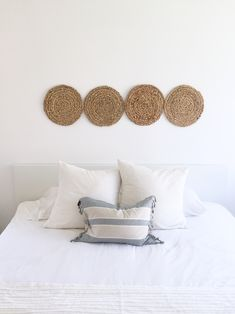 Round woven art. Above the bed DIY art using placemats. Paint is Behr Snow Fall