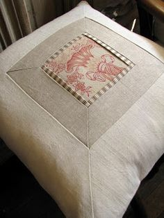 The Drill Hall Emporium. Antique textiles made into pillows.