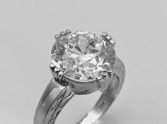 """A large """"old european cut """" diamond ct. 6.02 solitaire ring"""