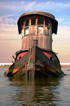 An old tugboat in a ship graveyard off Staten Island, New York. photo (c) Steve Miller Old Buildings, Abandoned Buildings, Abandoned Places, Abandoned Asylums, Abandoned Castles, Abandoned Ships, Abandoned Cars, Ghost Ship, Old Boats