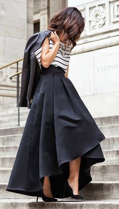 Krystal Bick in a black and white striped silk top, black ballgown skirt and a black leather jacket Top, skirt and jacket: St. John; Shoes: Saint Laurent; Clutch: Charlotte Olympia