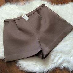 Kate spade brown scuba shorts Lovely brown scuba material makes these perfect for any season. Thrown on some tights, over the knee boots and a cable knit sweater and its perfect for fall! Offers welcome through offer tab. No trades. By kate spade saturday. kate spade Shorts