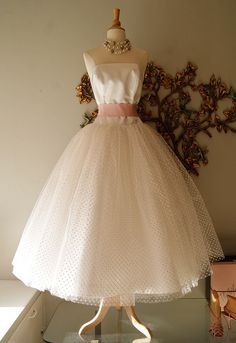 Love this 50's style wedding dress, available now in the bridal salon. modern size 12.