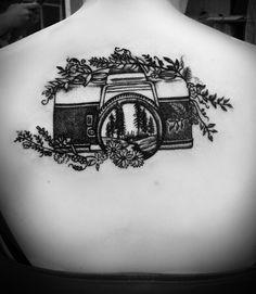 Nature camera tattoo.  Camera, outdoors, tree scene, back tattoo, photographer