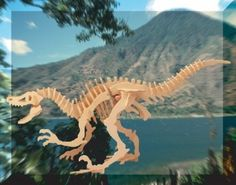 """Velociraptor Dinosaur 3D Woodcraft Construction Kit by Puzzled. $6.38. Velociraptor Woodcraft Construction Kit. NO cutting tools or glue required since all designs are pre-cut. 47 piece Wooden 3D Puzzle. Assembled Size: 19 1/2"""" L x 6"""" W x 11"""" H. All pieces interlock with each other forming a 3D model. This is a Woodcraft Construction Kit of a Velociraptor Dinosaur. It is made of 47 - 3mm wooden plywood pieces and when assembled measures 19 1/2"""" L x 6"""" W x 11"""" H. These Woodcr..."""