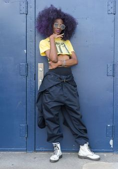 """New Trending Street Style: Nichole""""I'm wearing a top from For My Girls Shop, and a....  Nichole """"I'm wearing a top from For My Girls Shop, and a jumpsuit worn as pants from a vintage store in Detroit. Powerful women, hip hop, neon colors, sportswear, and street design inspire my style."""" Aug26,2017 ∙ Afropunk Festival"""