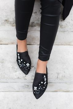 A flat that's high-fashion enough to wear after dark, KG Kurt Geiger's Okka style comes encrusted with pearls and beads to turn heads with every step. In wearable black, this backless shoe slips on with ease and features a subtle heel.