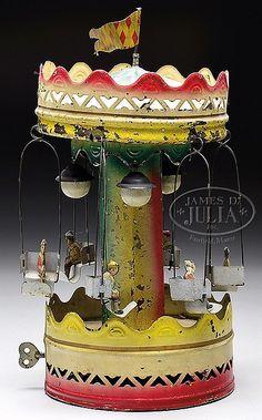 GERMAN CLOCKWORK SWING CAROUSEL.