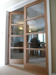Internal doors made from oak with glass paneling throughout; providing a simple … Internal doors made from oak with glass paneling throughout; providing a simple yet elegant transition from living room to dining room. Inside Doors, Interior, Home, Room Doors, Doors Interior, Internal Glass Doors, Oak Doors, French Doors Interior, Glass Doors Interior