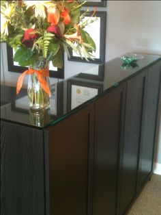 "Billy Bookcases with custom 1/2"" glass top as reception counter (view 2)"