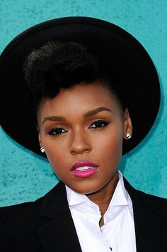 The Feisty Singer Janelle Monae Typically Wears Her Hair In An Updo Wi